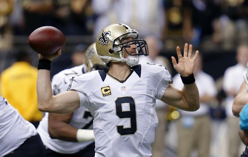 New Orleans Saints quarterback Drew Brees (9) passes in the first half of an NFL football game against the Miami Dolphins in New Orleans, Monday, Sept. 30, 2013. (AP Photo/Bill Haber)
