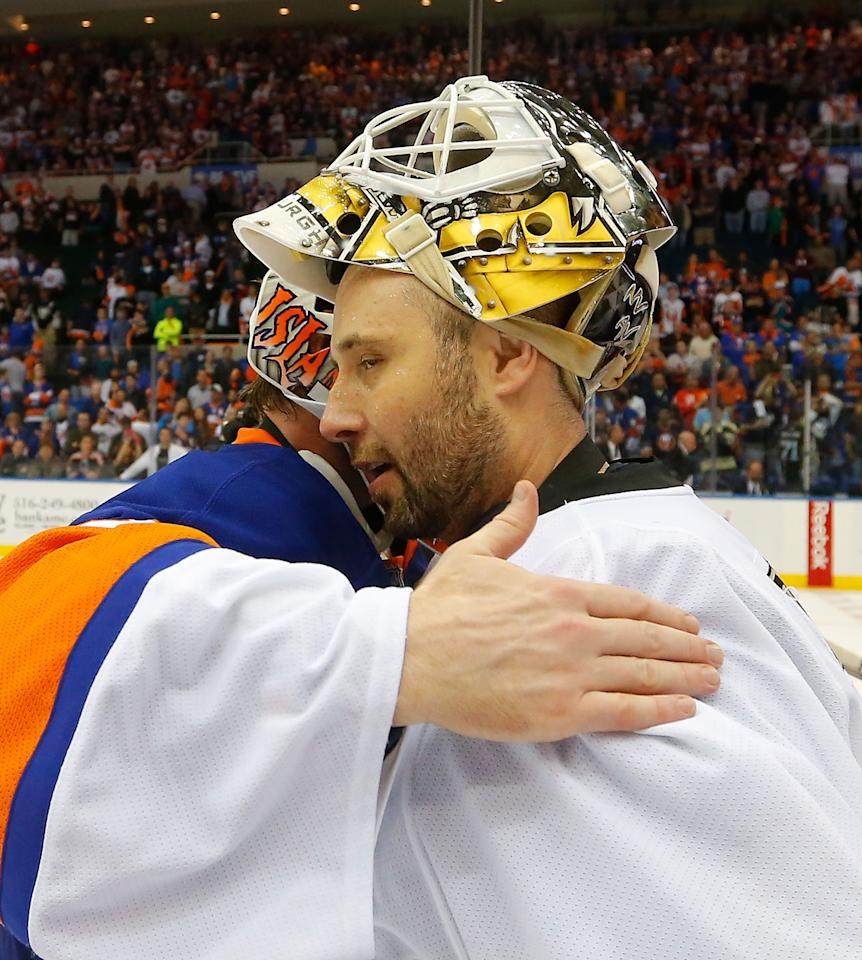 UNIONDALE, NY - MAY 11:  Goalie Evgeni Nabokov #20 of the New York Islanders hugs goalie Tomas Vokoun #92 of the Pittsburgh Penguins after the Islanders were eliminated from the playoffs in Game Six of the Eastern Conference Quarterfinals  during the 2013 NHL Stanley Cup Playoffs at Nassau Veterans Memorial Coliseum on May 11, 2013 in Uniondale, New York.  Penguins won 4-3 in overtime.  (Photo by Paul Bereswill/Getty Images)