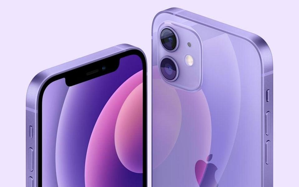 A press image released by Apple of a shining purple iPhone, its dual cameras and bevelled screen glistening  - Apple