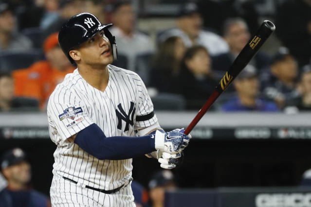 New York Yankees' Gleyber Torres watches his home run against the Houston Astros during the eighth inning in Game 3 of baseball's American League Championship Series Tuesday, Oct. 15, 2019, in New York. (AP Photo/Matt Slocum)