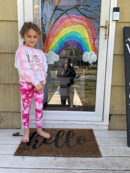 PHOTO: Londyn Donnelly, 6, stands beside a painted rainbow she created to spread hope and joy in her Long Island, New York, community amid the coronavirus crisis. (Michelle Battaglia)