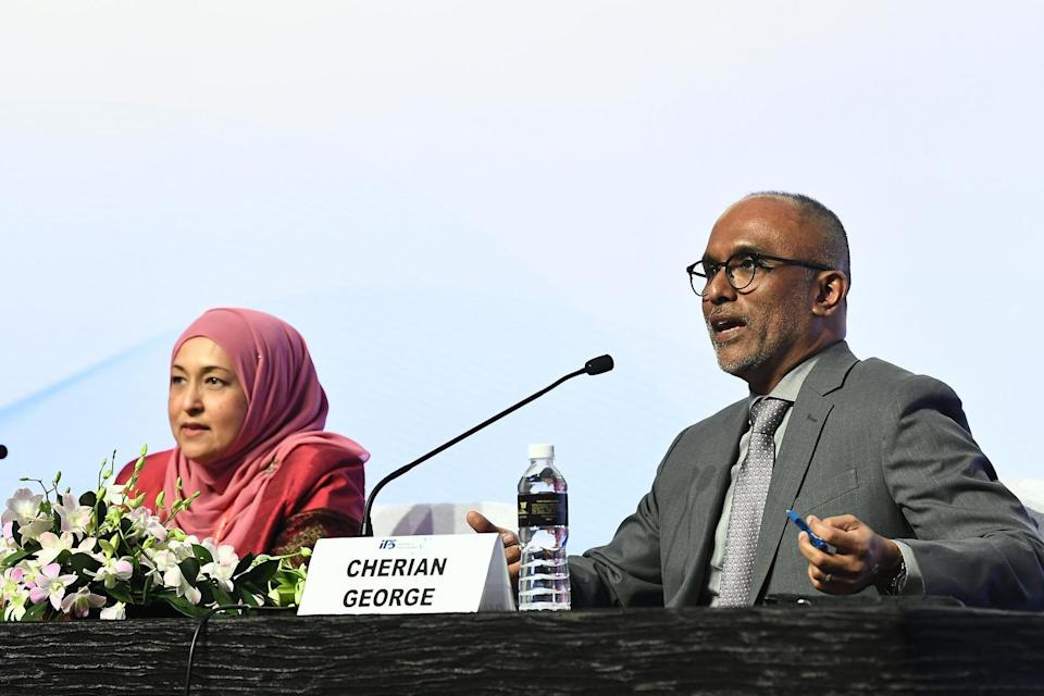 File photo of Hong Kong Baptist University media professor Cherian George (right) speaking at a conference to mark the 30th anniversary of the Institute of Policy Studies in October 2018.