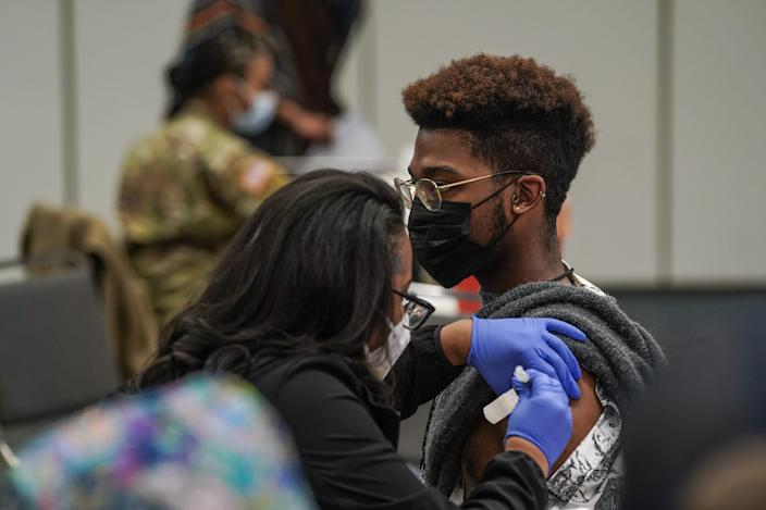 Parris Howard of Sterling Heights gets his COVID-19 vaccine during the first day of a walk-up indoor vaccination at TCF Center in downtown Detroit on Monday.