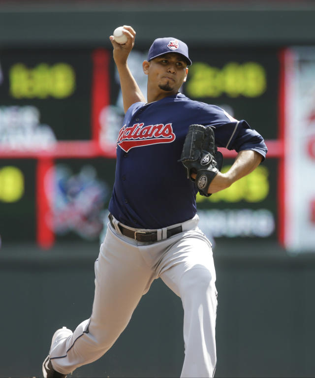 Cleveland Indians pitcher Carlos Carrasco throws against the Minnesota Twins in the first inning of a baseball game, Wednesday, Aug. 14, 2013 in Minneapolis. (AP Photo/Jim Mone)