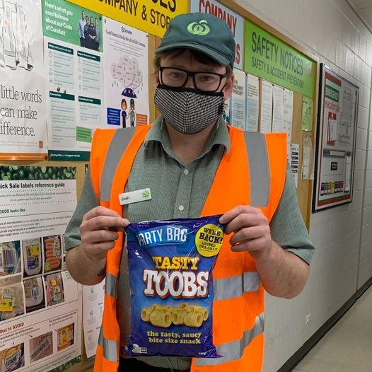 Woolworths worker holding Tasty Toobs pack. Source: Facebook (SDA NT & SA Page)