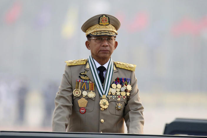 FILE - In this March 27, 2021, file photo, Myanmar's Commander-in-Chief Senior Gen. Min Aung Hlaing presides an army parade on Armed Forces Day in Naypyitaw, Myanmar. The military takeover of Myanmar early in the morning of Feb. 1 reversed the country's slow climb toward democracy after five decades of army rule. But Myanmar's citizens were not shy about demanding their democracy be restored. (AP Photo, File)