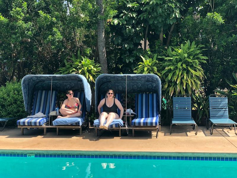 Me, at right, sitting by the pool in Hawaii in my size-20 swimsuit