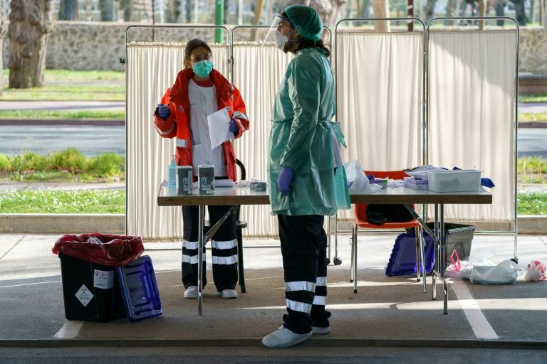 Healthcare workers have also set up drive-in test centres (AFP Photo/CESAR MANSO)
