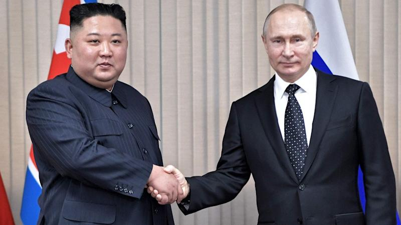 Russia's Vladimir Putin calls for 'international guarantees' in first summit with North Korea's Kim Jong-un