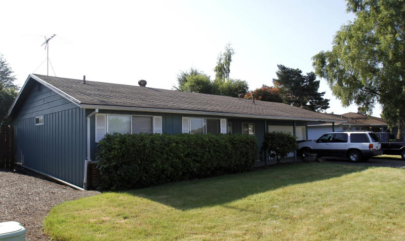 The house where a deceased family of four was found Wednesday, is shown Thursday, July 5, 2012, in Dundee, Ore. Police Capt. Jeff Kosmicki said Thursday that the preliminary investigation leads them to believe that the deaths are a murder-suicide. A statement Thursday from the Newberg-Dundee police named two of the dead, 37-year-old Randall Engels and 35-year-old Amy Engels. It said their children, who were not named, were also victims. (AP Photo/Don Ryan)(AP Photo/Don Ryan)
