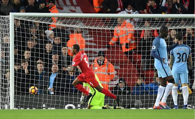Liverpool's Dutch midfielder Georginio Wijnaldum (C) celebrates after scoring the opening goal of the English Premier League football match between Liverpool and Manchester City at Anfield in Liverpool, north west England on December 31, 2016 (AFP Photo/Paul ELLIS)