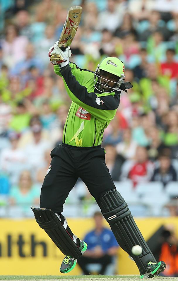SYDNEY, AUSTRALIA - DECEMBER 28:  Chris Gayle of the Thunder bats during the Big Bash League match between the Sydney Thunder and the Brisbane Heat at ANZ Stadium on December 28, 2012 in Sydney, Australia.  (Photo by Mark Metcalfe/Getty Images)