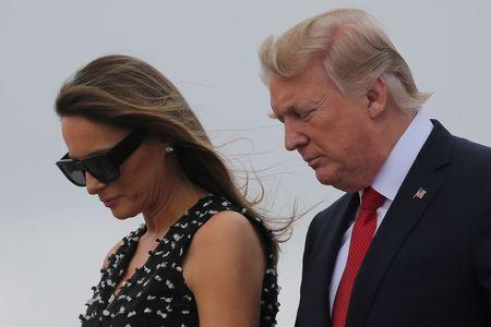 FILE PHOTO: U.S. President Donald Trump and first lady Melania Trump arrive at Palm Beach International Airport in West Palm Beach