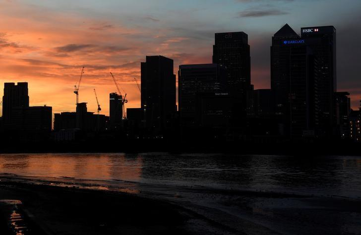 The Canary Wharf business district is seen at dusk in London, Britain December 11, 2016. REUTERS/Toby Melville/Files