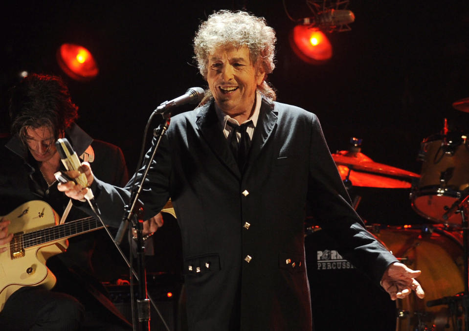 "FILE - Musician Bob Dylan performs in Los Angeles on Jan. 12, 2012. Transcripts of lost 1971 Dylan interviews with the late American blues artist Tony Glover and letters the two exchanged reveal that Dylan changed his name from Robert Zimmerman because he worried about anti-Semitism, and that he wrote ""Lay Lady Lay"" for actress Barbra Streisand. The items are among a trove of Dylan archives being auctioned in November 2020 by Boston-based R.R. Auction. (AP Photo/Chris Pizzello, File)"
