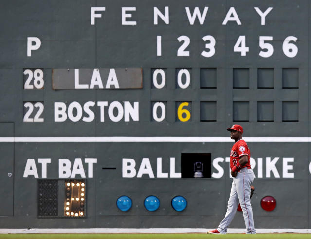 Los Angeles Angels left fielder Justin Upton walks back to his position after the Boston Red Sox scored six runs on three home runs during the second inning of a baseball game at Fenway Park in Boston, Wednesday, June 27, 2018. (AP Photo/Charles Krupa)