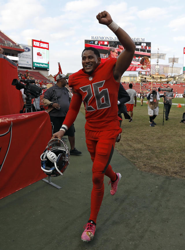 Tampa Bay Buccaneers defensive back Andrew Adams (26) runs off the field after the Buccaneers defeated the Carolina Panthers 24-17 during an NFL football game Sunday, Dec. 2, 2018, in Tampa, Fla. (AP Photo/Mark LoMoglio)