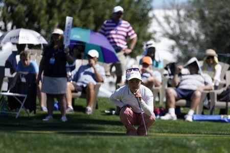Mar 29, 2018; Rancho Mirage, CA, USA; Ayako Uehara lines up her putt on the 18th hole during the first round of the ANA Inspiration women's golf tournament at Mission Hills CC - Dinah Shore Tournament Course. Mandatory Credit: Kelvin Kuo-USA TODAY Sports