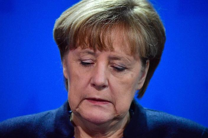 Apparent security failings in Germany have triggered fresh criticism of Chancellor Angela Merkel's refugee policy (AFP Photo/John MACDOUGALL)