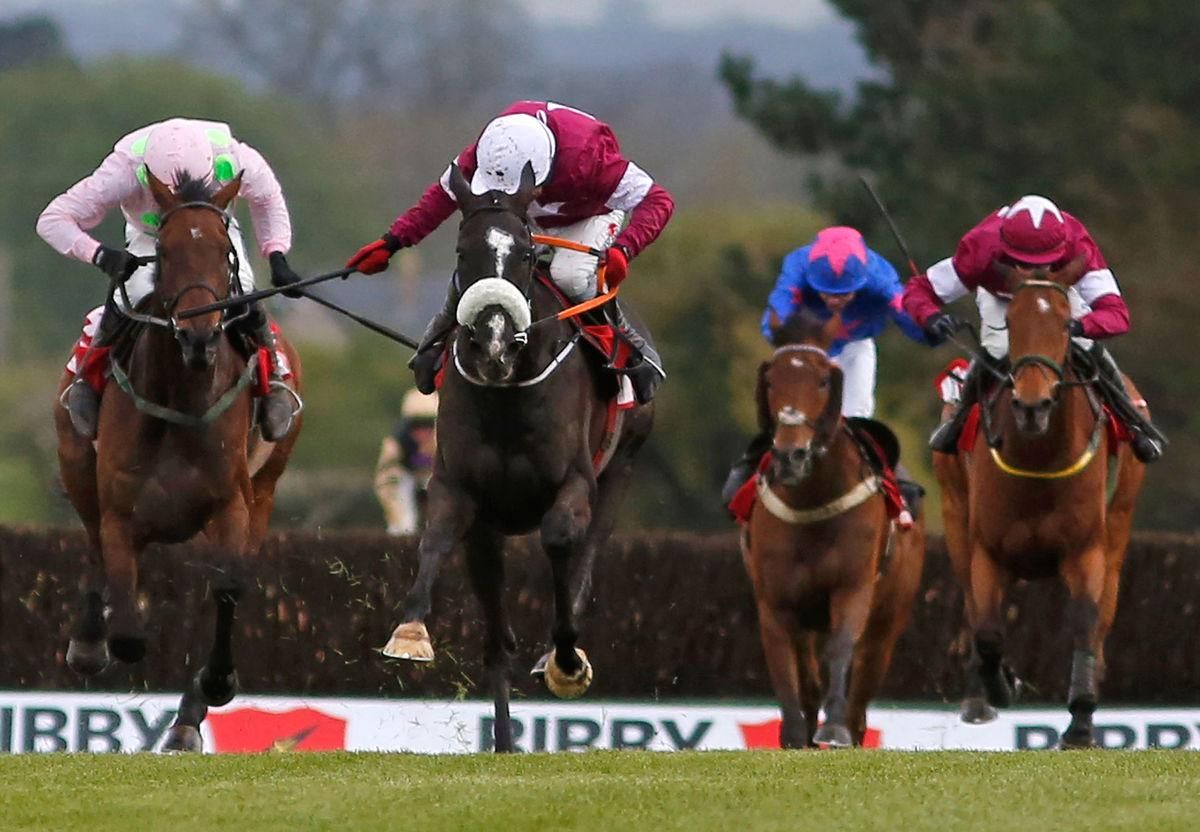 NAAS, IRELAND - APRIL 29: Paul Carberry riding Don Cossack (C) clear the last to win The Bibby Financial Services Ireland Punchestown Gold Cup at Punchestown racecourse on April 29, 2015 in Naas, Ireland. (Photo by Alan Crowhurst/Getty Images)