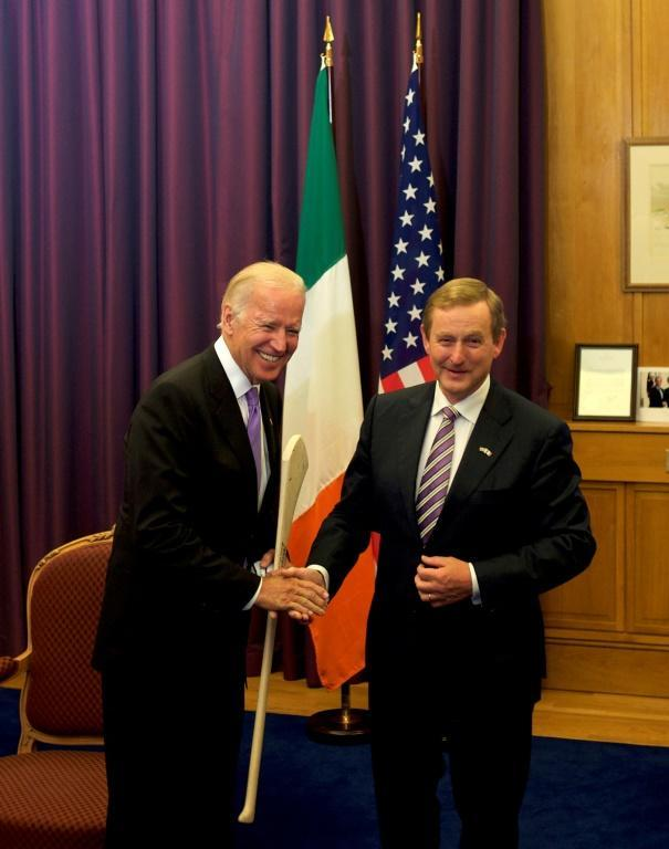 Then US vice president Joe Biden receives a hurl as a welcome gift from Ireland's then prime minister Enda Kenny, in Dublin in June 2016