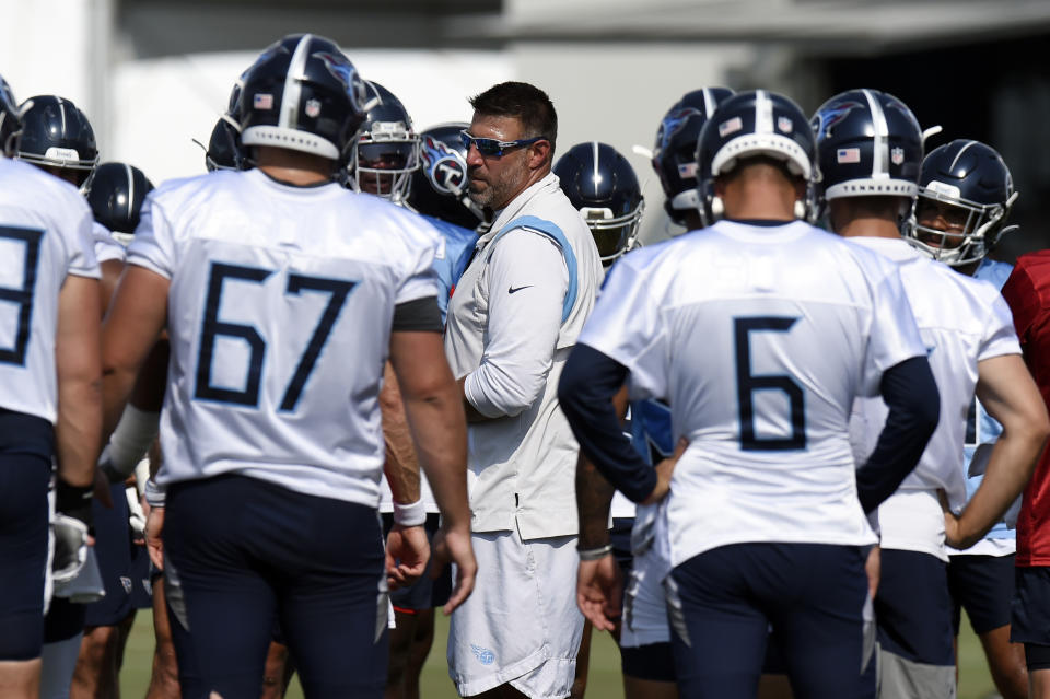 Tennessee Titans head coach Mike Vrabel talks to his players during NFL football training camp Friday, July 30, 2021, in Nashville, Tenn. (AP Photo/Mark Zaleski)