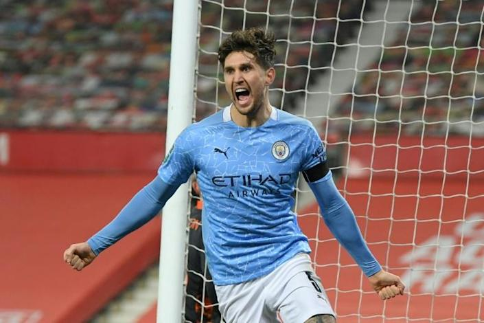 John Stones opened the scoring as Manchester City beat Manchester United to reach the League Cup final