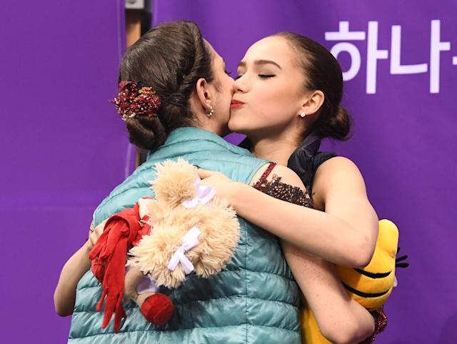 <p>Russia's Alina Zagitova (R) hugs Russia's Evgenia Medvedeva after the women's single skating free skating of the figure skating event during the Pyeongchang 2018 Winter Olympic Games at the Gangneung Ice Arena in Gangneung on February 23, 2018. / AFP PHOTO / Roberto SCHMIDT </p>
