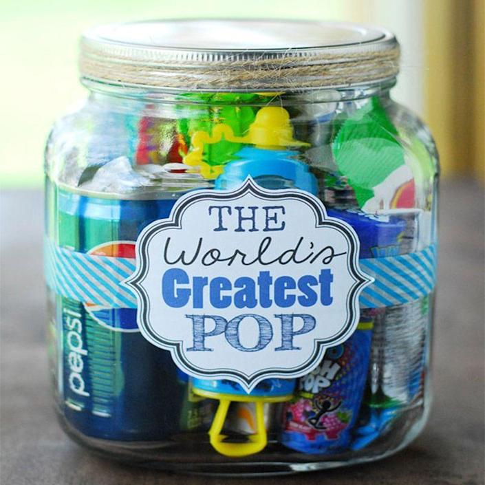 """<p>The Dad who loves puns will especially love this fun gift. Fill a jar with products relating to """"Pop"""" like Pop Rocks, soda pop, and popcorn to bring a smile to Dad's face. </p><p><em>Get the tutorial at <a href=""""https://www.thegunnysack.com/fathers-day-gift-ideas-worlds-greatest-pop-gift-in-a-jar/"""" rel=""""nofollow noopener"""" target=""""_blank"""" data-ylk=""""slk:The Gunny Sack"""" class=""""link rapid-noclick-resp"""">The Gunny Sack</a>.</em></p>"""