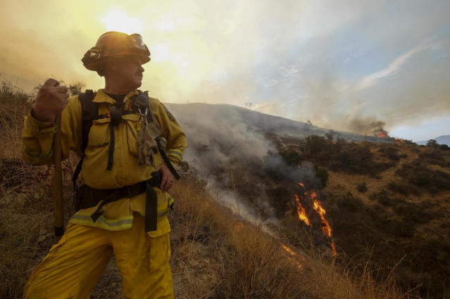 <p>A member with California Department of Forestry and Fire Protection (Cal Fire) battles a brushfire on the hillside in Burbank, Calif., Saturday, Sept. 2, 2017. (Photo: Ringo H.W. Chiu/AP) </p>