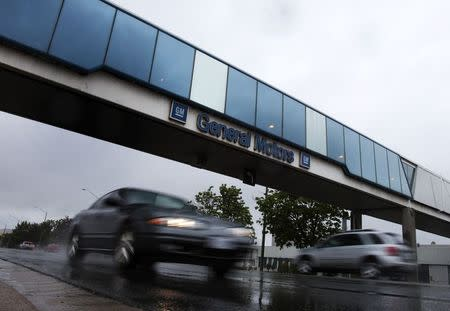File photo of cars passing under an overpass at the General Motors Car assembly plant in Oshawa