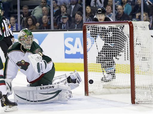 Minnesota Wild goalie Darcy Kuemper is beaten for a goal on a shot from San Jose Sharks center Logan Couture during the third period of an NHL hockey game in San Jose, Calif., Thursday, April 18, 2013. (AP Photo/Marcio Jose Sanchez)