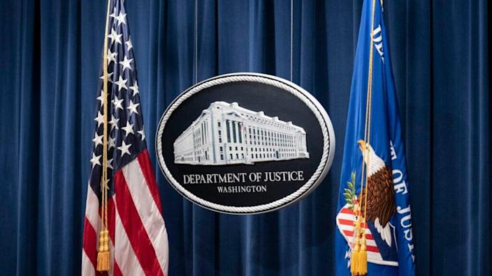 A sign for the Department of Justice as seen on January 12, 2021 in Washington, DC. (Photo by Sarah Silbiger-Pool/Getty Images)