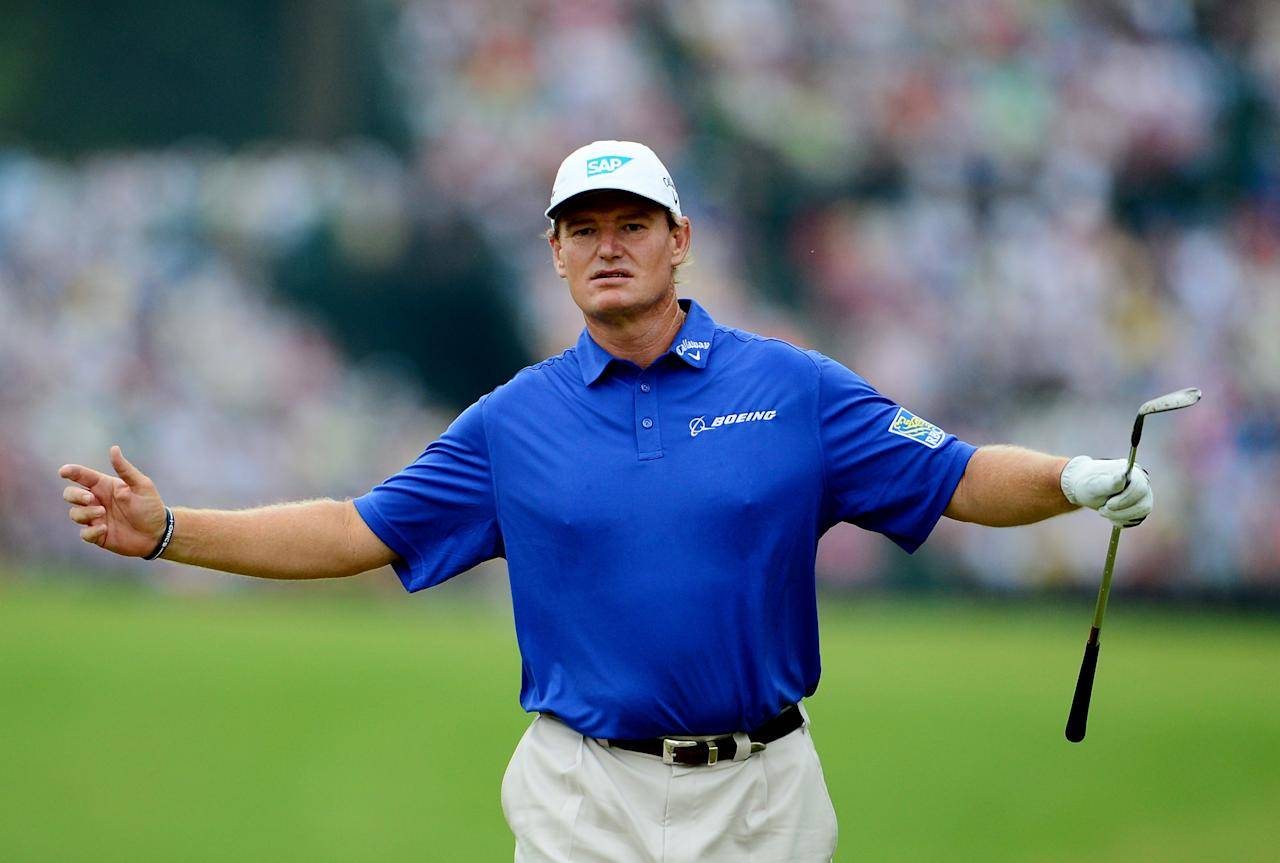 ARDMORE, PA - JUNE 16: Ernie Els of South Africa reacts to his third shot on the 18th hole during the final round of the 113th U.S. Open at Merion Golf Club on June 16, 2013 in Ardmore, Pennsylvania. (Photo by David Cannon/Getty Images)
