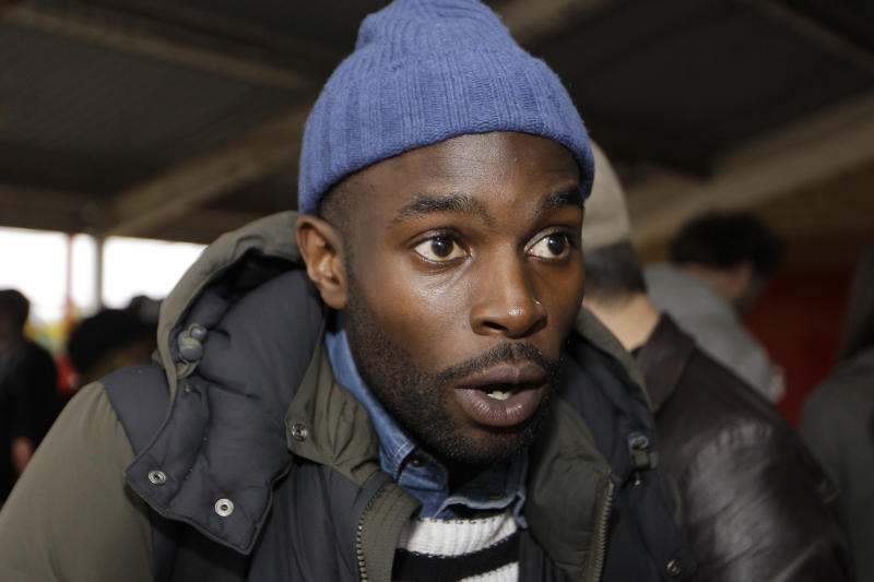 """This  Wednesday, May 2, 2012 photo shows organizer of the 'Other Cinema' project, Issac Densu speaking to Associated Press at Broadwater Farm Community Center in north London before the free screening of """"La Haine"""" (""""Hate""""), a powerful 1995 film about alienated youth on the impoverished high-rise fringes of Paris. Densu lives in Broadwater Farm, a large, concrete public housing estate in Tottenham, the gritty and deprived district where last year's riots began. Unemployment is high, and young people face many temptations to get into trouble. Densu thinks he knows what might help: a good movie. The film-loving 26-year-old thinks watching movies can help his neighbors expand their horizons and embrace creativity, rather than violence. (AP Photo/Sang Tan)"""