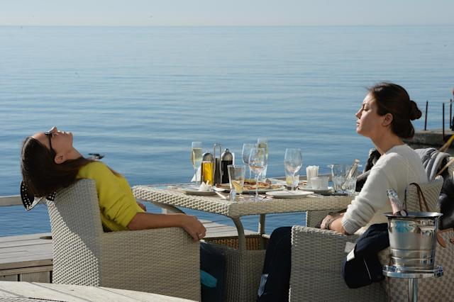 SOCHI, RUSSIA - FEBRUARY 13: People enjoy the sun on a restaurant terrace along the black sea on day six of the Sochi 2014 Winter Olympics on February 13, 2014 in Sotchi, Russia. (Photo by Pascal Le Segretain/Getty Images)