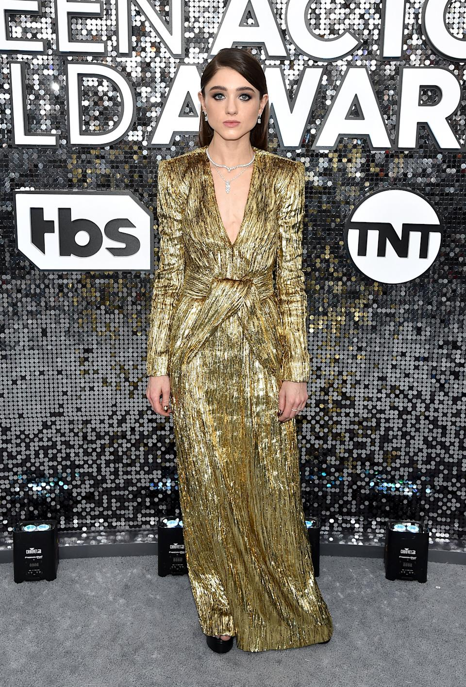 """<h2>Natalia Dyer in Saint Laurent by Anthony Vaccarello</h2><br>Natalia Dyer took inspiration from the show that she stars in with this '80s-inspired gold metallic gown. <span class=""""copyright"""">Photo by John Shearer/Getty Images for PEOPLE.</span>"""