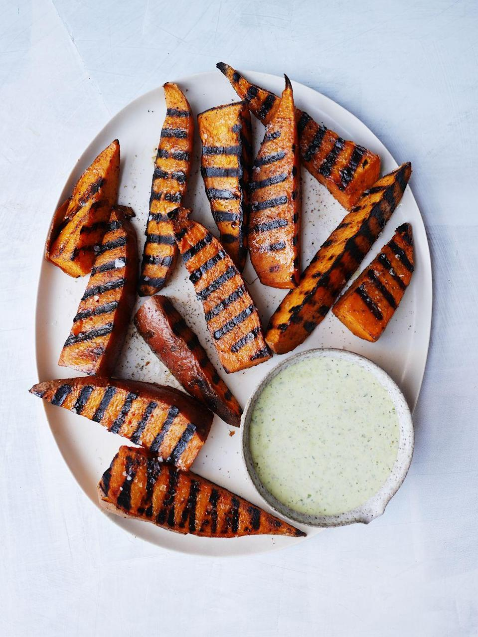 """<p>These sweet potato wedges are STURDY.</p><p>Get the recipe from <a href=""""https://www.delish.com/cooking/recipe-ideas/a21087533/easy-grilled-sweet-potatoes-recipe/"""" rel=""""nofollow noopener"""" target=""""_blank"""" data-ylk=""""slk:Delish"""" class=""""link rapid-noclick-resp"""">Delish</a>. </p>"""