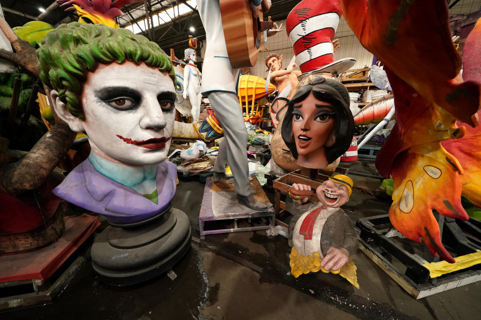 Parts of Mardi Gras floats created by Kern Studios sit stored inside Mardi Gras World in New Orleans, Friday, Feb. 12, 2021. New Orleans' annual pre-Lenten Mardi Gras celebration is muted this year because of the coronavirus pandemic. Parades canceled. Bars closed. Crowds suppressed. Mardi Gras joy is muted this year in New Orleans as authorities seek to stifle the coronavirus's spread. And it's a blow to the tradition-bound city's party-loving soul. (AP Photo/Gerald Herbert)