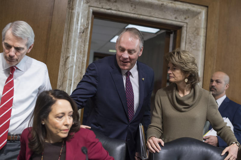 Interior Secretary Ryan Zinke, center, arrives to testify at a Senate Energy and Natural Resources Committee hearing on Tuesday. Also pictured are Chairwoman Lisa Murkowski (R-Alaska) (right), Sen. Maria Cantwell (D-Wash.) and Sen. Rob Portman (R-Ohio) (left). (Tom Williams via Getty Images)