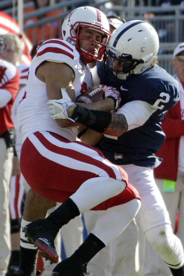 Penn State cornerback Chaz Powell (2) tackles Nebraska tight end Kyler Redd after a 15-yard pass play during the second quarter of an NCAA college football game in State College, Pa., Saturday, Nov. 12, 2011. (AP Photo/Gene J. Puskar)