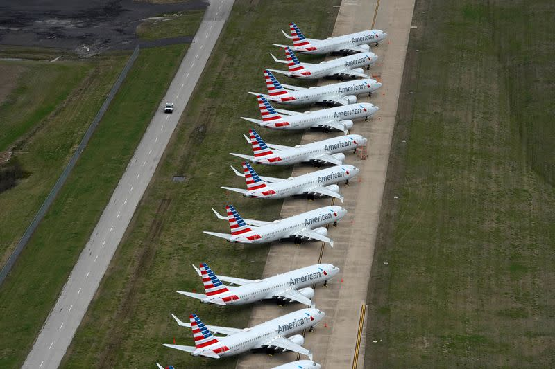 American Airlines 737 max passenger planes are parked on the tarmac at Tulsa International Airport in Tulsa