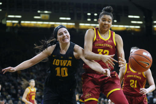 Iowa forward Megan Gustafson, left, fights for a rebound with Iowa State forward Meredith Burkhall during the first half of an NCAA college basketball game, Wednesday, Dec. 5, 2018, in Iowa City, Iowa. (AP Photo/Charlie Neibergall)