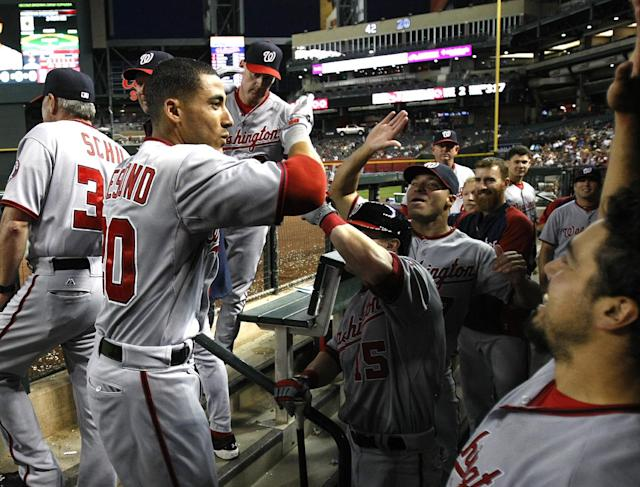 Washington Nationals Ian Desmond, second from left, celebrates after hitting a solo homerun against the Arizona Diamondbacks in the fourth inning during a baseball game, Monday, May 12, 2014, in Phoenix. (AP Photo/Rick Scuteri)