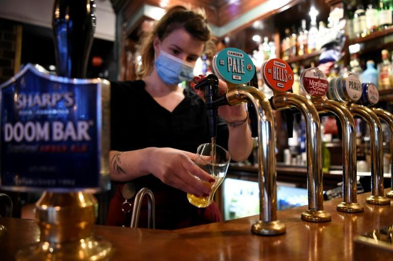 A server pours a pint of Camden Pale Ale inside a pub in Mayfair, London as the country prepares for a second national lockdown