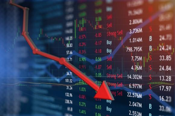 Stock market data on a colorful display with a red arrow line indicating losses