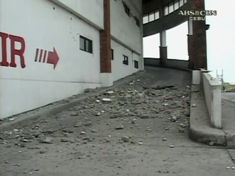 Still image of debris seen on the ground after an earthquake which caused the collapse of several buildings in Cebu City