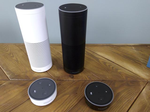 Amazon Echos and Echo Dots on a table. (Reuters)