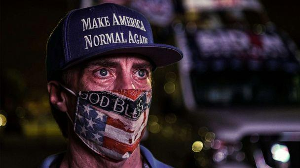 PHOTO: A supporter of the Democratic party attends a watch party in Miami, Nov. 3, 2020. (Chandan Khanna/AFP via Getty Images)