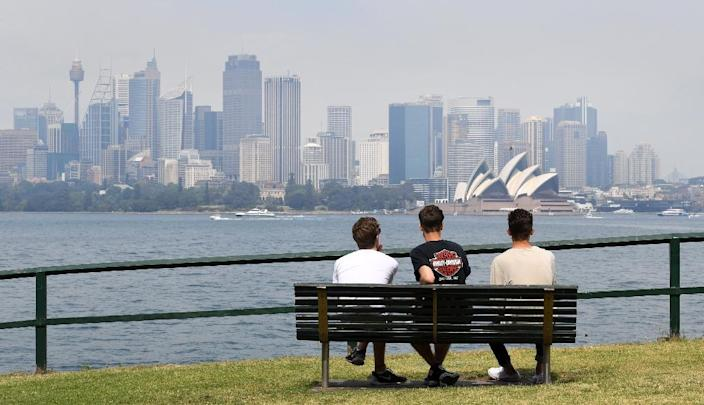 Some seventy-five percent of migrants to Australia have moved to Sydney, Melbourne and southeast Queensland The smoke drifted over the city from burn-offs on the city fringes, which were done as a preventative measure for the upcoming bushfire season. (AFP Photo/WILLIAM WEST)